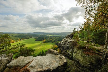 Autumn colorful landscape with forests, hills, sun and sky Reklamní fotografie