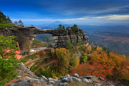 Pravcicka brana, rock monument, sandstone gate. Biggest natural bridge in Europe. Bohemian Switzerland, Hrensko, Czech Republic. Rocky landscape, autumn. Beautiful nature with stone, forest and fog. Stok Fotoğraf