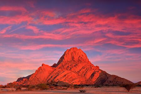 Spitzkoppe, beautiful hill in Namibia. Rock monument in the nature. Landscape in namibia. Stone in the nature, evening light in the rocky desert. Travel in Namibia, Africa. Große Spitzkoppe monument.