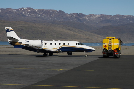 cistern: White-blue-gold private jet and yellow cistern car