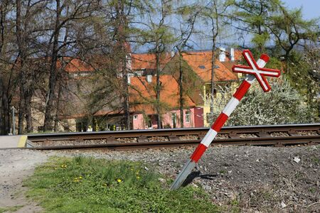 sloping: Sloping railway red and white cross by the road