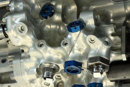 alluminum: Very complex alluminum valve detail with blue nuts Stock Photo