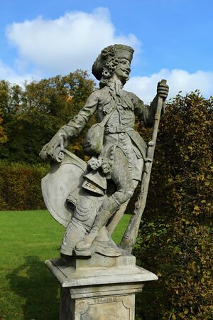 fine legs: Statue of the soldier with the gun and harness Stock Photo