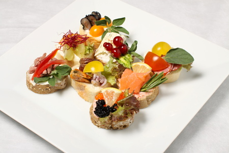 canapes: White plate with eight pieces of canapes
