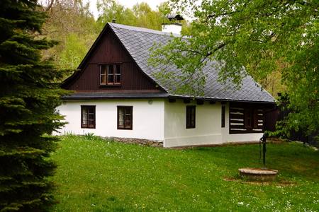 country house: Old bohemia classic house with the pump and green lawn Stock Photo