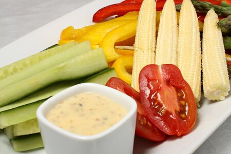 cuke: Cucumber, corn and tomato detail with french sauce Stock Photo