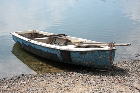 Various rowboat on the summer beach dam photo
