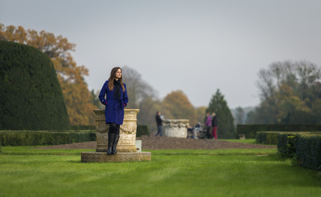 beautiful girl in the park resting on a small fountain photo