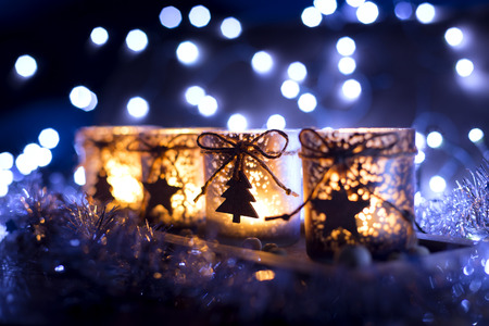 Advent, four candles decorated Christmas tree on a background of lights photo