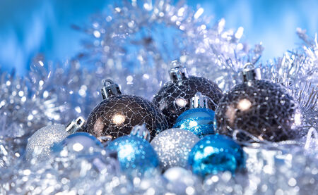 Christmas balls coated with tinsel and turquoise background color photo