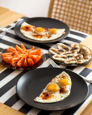 modest: modest home breakfast bread, eggs, tomatoes, mozzarella, latte Stock Photo