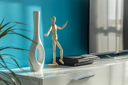 residential home: Modern sunny living room with vase and wooden figure Stock Photo