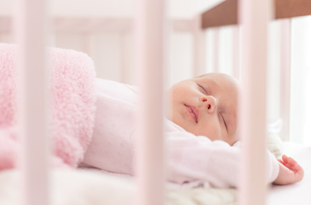 sleep baby: beautiful newborn sleep in crib Stock Photo