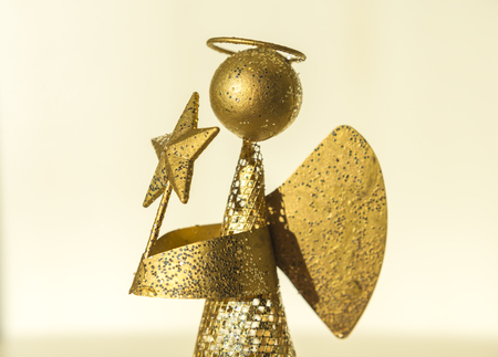 osos navide�os: angel with star in the hands produced from waste metal, gold plated