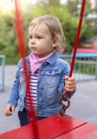 argue kid: The unfortunate little girl on the playground, separated from the collective. Stock Photo