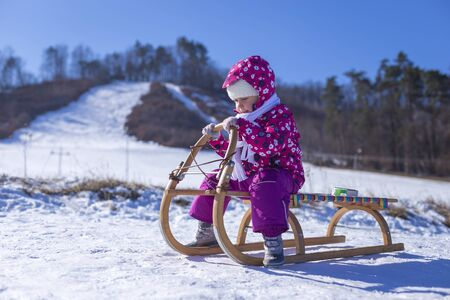 outdoor fun for family christmas vacation little girl enjoying a sleigh ride child sledding children play outdoors in snow - Christmas Vacation Sled
