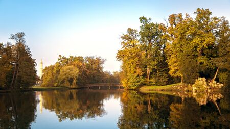 beautiful view of the park in Lednice on the lake, bridge and minaret in autumn