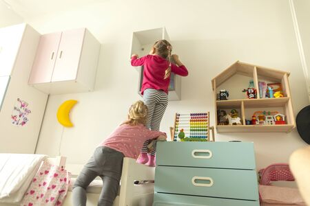 Sisters playing at home fun in the children's little room