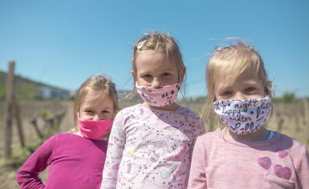 Happy children in Eastern Europe protecting themselves with a face mask from coronavirus. Slovakia