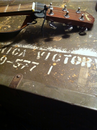 Fender acoustic on WWII trunk