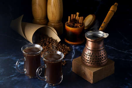 Turk and two cups of hot coffee with spices