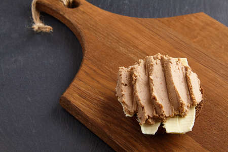 Sandwich with homemade pate spread on rye bread with butter