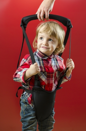 A Cute Baby making his First Steps with a harness Standard-Bild