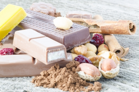 Chocolate and ingredients on rustic background photo
