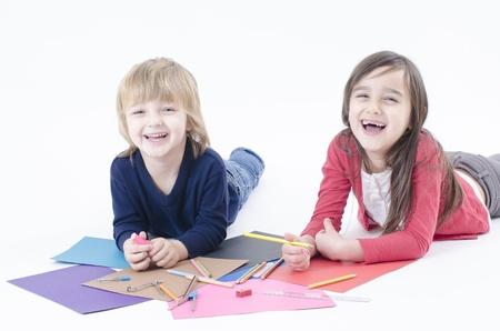 Two happy children doing homework
