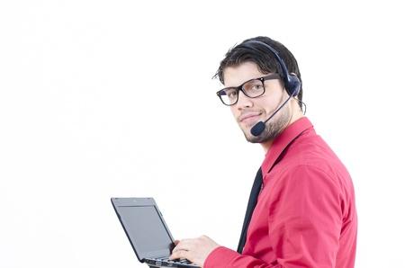 彼の机で男性の顧客サービス担当者 写真素材