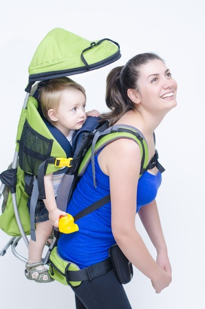 baby carrier: A young woman trekking with her baby Stock Photo