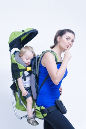 family activities: A young woman trekking with her baby Stock Photo