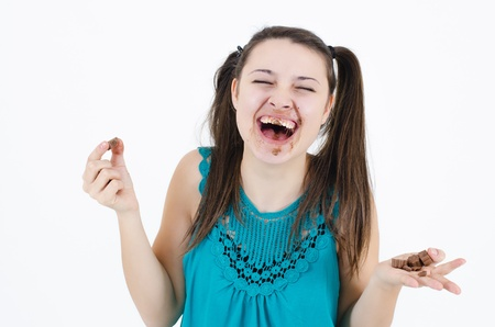 avid: A insatiable girl girl holding a piece of chocolate Stock Photo