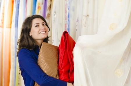 Client in a textiles shop choosing draperies