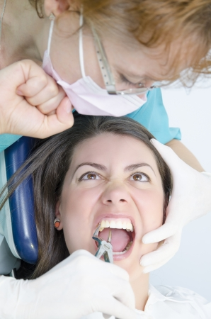 extraction: A young girl is scared at a tooth extraction