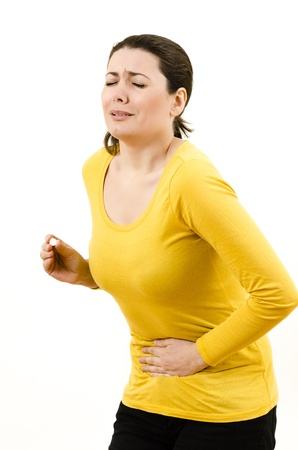 menstrual: Young woman with stomach  menstrual issues