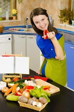 Beautiful smiling woman preparing fresh meal photo