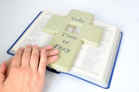 worshiper: clasped hands for pray on a bible Stock Photo