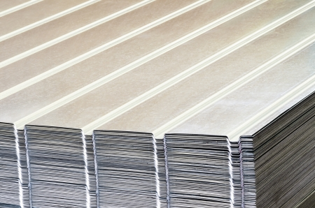 corrugated steel: Stack of corrugated steel sheet  in a warehouse