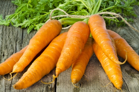 fresh carrots bunch on wood