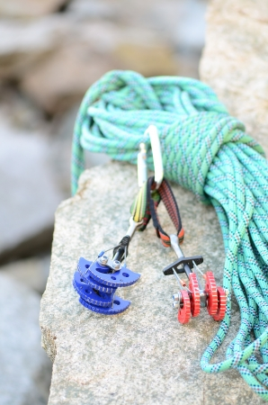 cam gear: climbing rope and cams on a granit rock