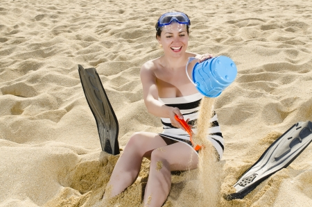 Young woman playing on beach photo