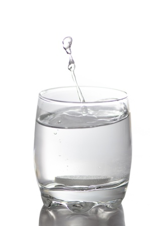 a water splash in a glass with calcium isolated on white photo