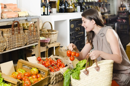 fibber: Beautiful woman talking on the phone receiving orders in a rustic store Stock Photo