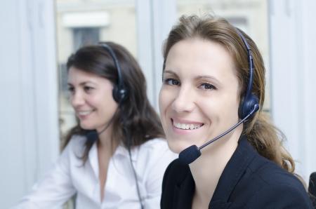 Female customer service representative at her desk photo