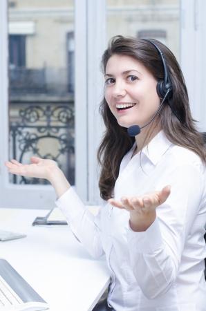 customer service representative: Female customer service representative at her desk Stock Photo