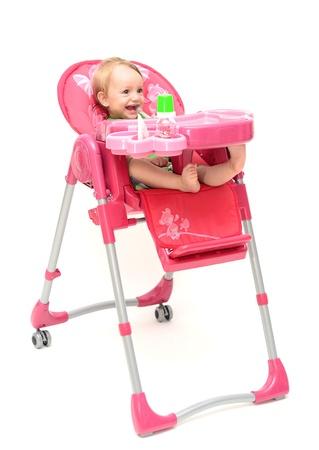 highchair: one year blond baby sitting on highchair