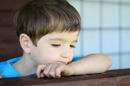wistful: a wistful child on his porch