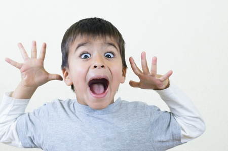 Little boy shouting and gesturing photo