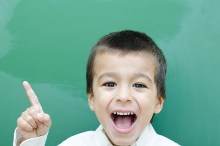 Little Boy Screaming Very Happy at Blackboard photo